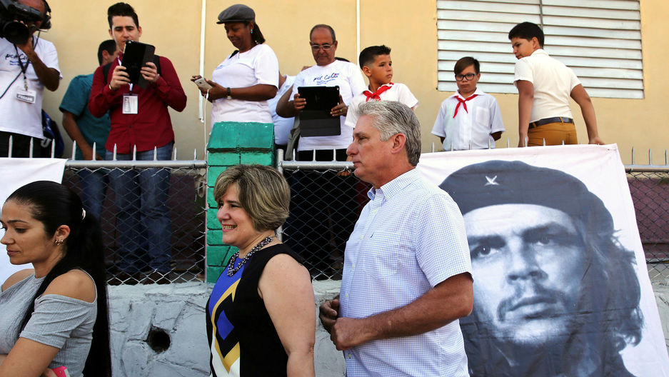 Cuba's First Vice-President Miguel Diaz-Canel and his wife Lis Cuesta stand in line before Diaz-Canel casts his vote during an election of candidates for the national and provincial assemblies.