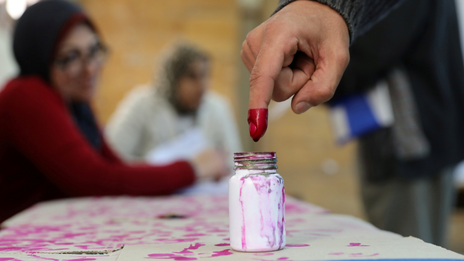 A voter's finger is marked with ink at a polling station during the second day of the presidential election in Alexandria, Egypt, March 27, 2018.