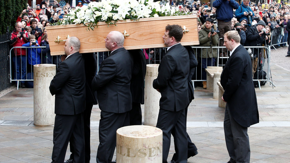 Pallbearers carry the coffin of Stephen Hawking into Great St. Mary's Church.