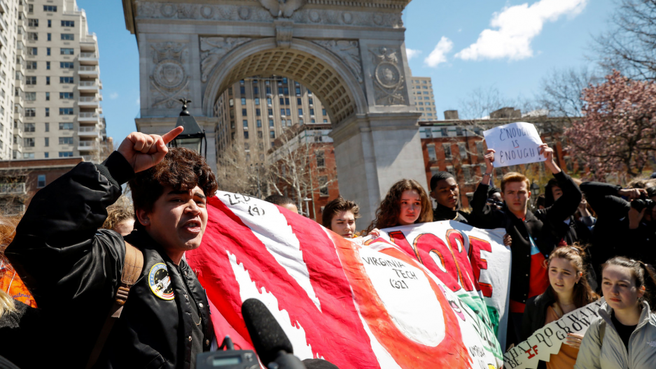 Students gather for a rally in Washington Square Park, as part of a nationwide walk-out of classes to mark the 19th anniversary of the Columbine High School mass shooting, in New York City on April 20, 2018.