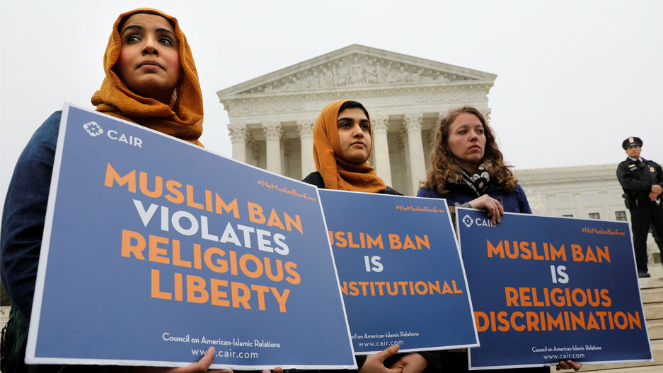 Protesters gather outside the U.S. Supreme Court in Washington, DC, U.S., April 25, 2018, while the court justices consider case regarding presidential powers as it weighs the legality of President Donald Trump's latest travel ban.
