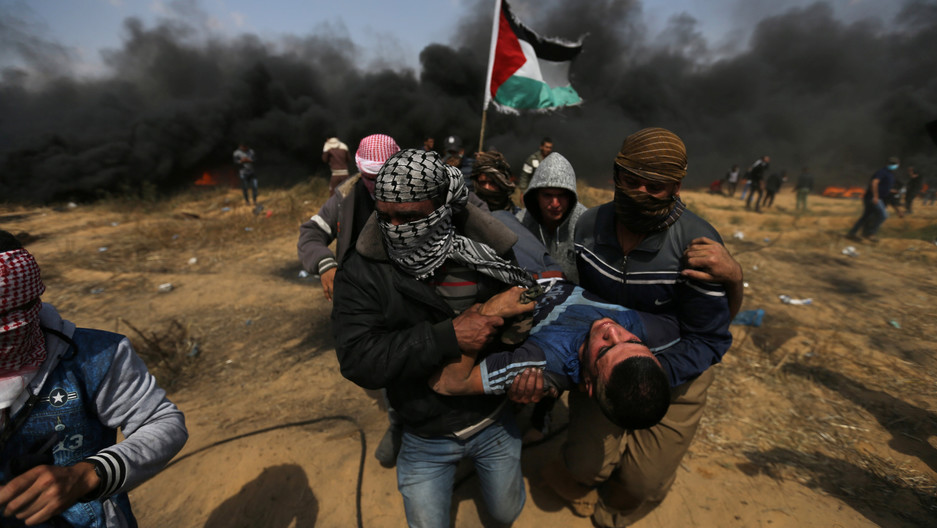 A wounded demonstrator is evacuated during clashes with Israeli troops at a protest where Palestinians demand the right to return to their homeland, at the Israel-Gaza border in the southern Gaza Strip, April 27, 2018.