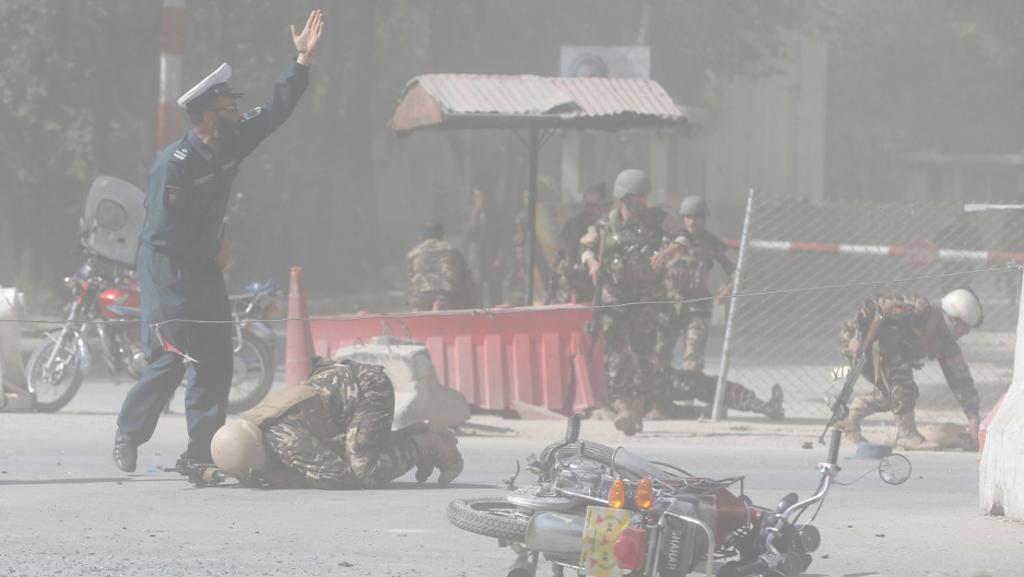 Afghan security forces are seen at the site of a second blast inKabul, Afghanistan April 30, 2018.