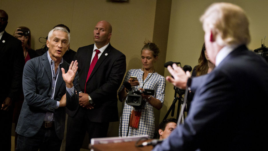 """Republican presidential candidate Donald Trump spars with Univision reporter Jorge Ramos before his """"Make America Great Again Rally"""" at the Grand River Center in Dubuque, Iowa, August 25, 2015."""