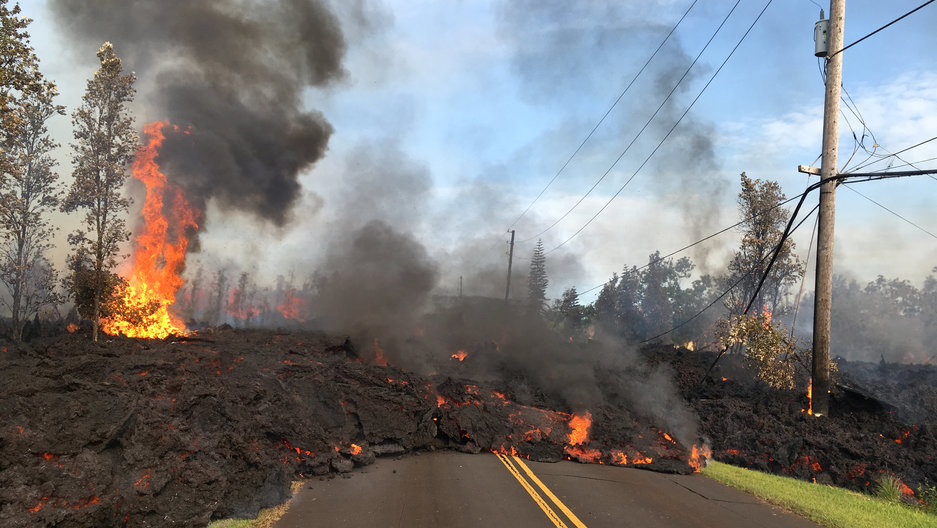 Lava advances along a street near a fissure in Leilani Estates, on Kilauea Volcano's lower East Rift Zone, Hawaii, May 5, 2018.