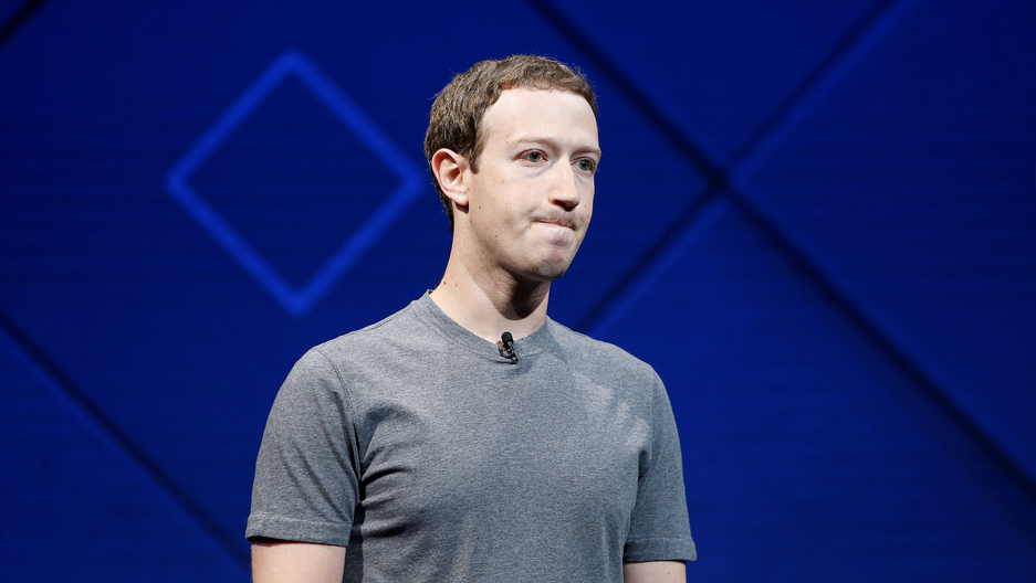 Facebook's Mark Zuckerberg standing on a stage wearing a grey t-shirt, in San Jose, Calif., 2017.