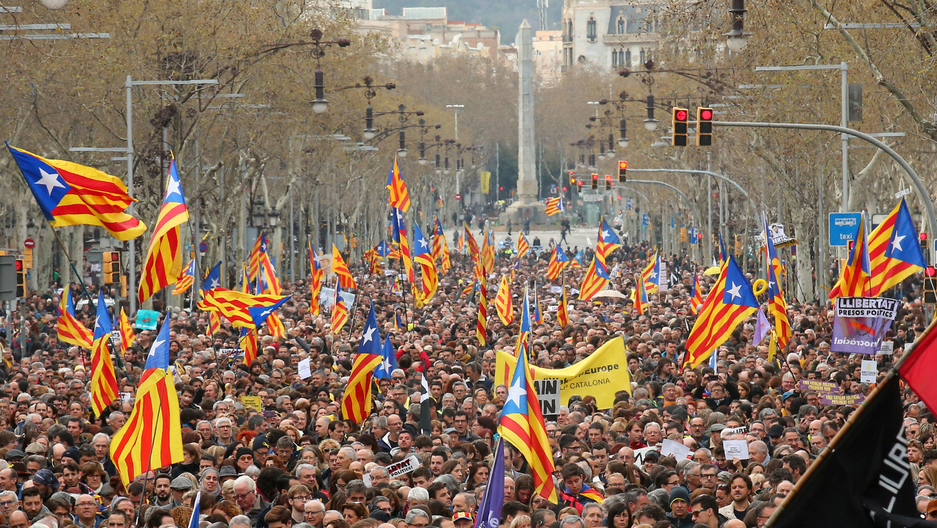People protest after former president Carles Puigdemont was detained in Germany, during a demonstration held by pro-independence associations in Barcelona, Spain March 25, 2018.