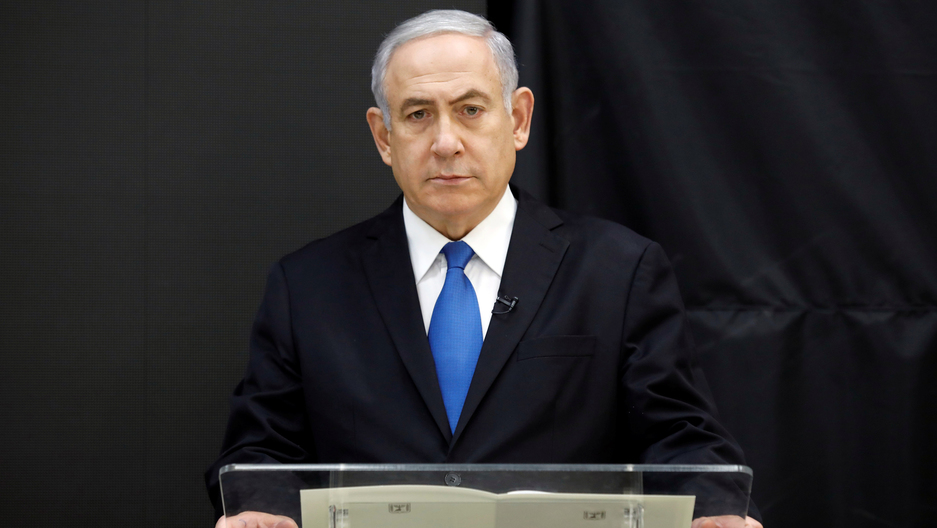 Israeli Prime Minister Benjamin Netanyahu stands at a podium speaking during a news conference in Tel Aviv.