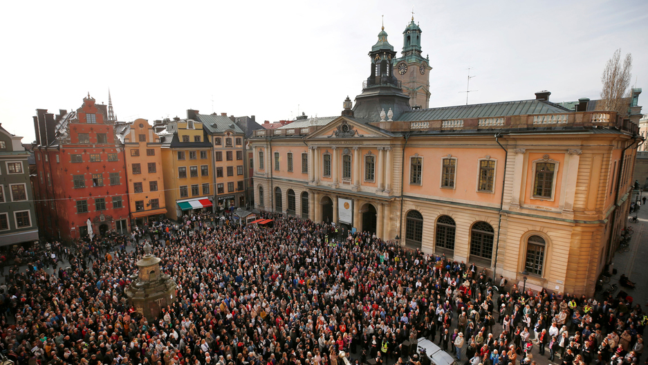 People gather in Stortorget square in Stockholm showing support for former Academy member and Permanent Secretary Sara Danius who stepped down last week.