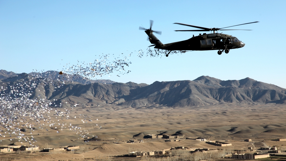 A helicopter drops leaflets in Afghanistan