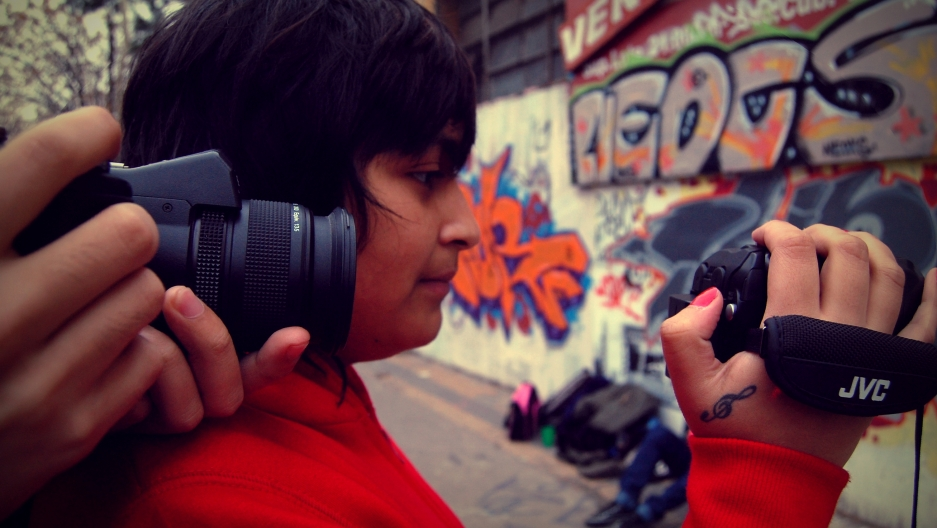 Teenagers film video in Argentina. A new study says that adolescents seem to have become more creative in visual arts.