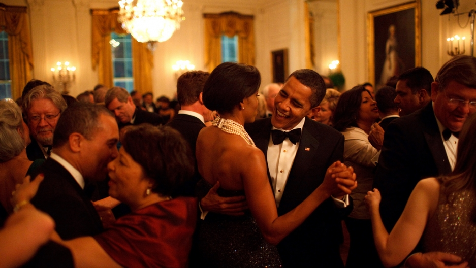 Former President and First Lady Michelle Obama dance together at the Governors Ball in 2009.