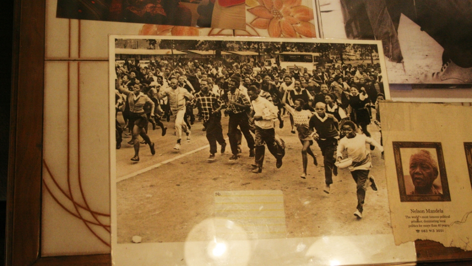 An old photograph of crowd running in Soweto, Johannesburg.