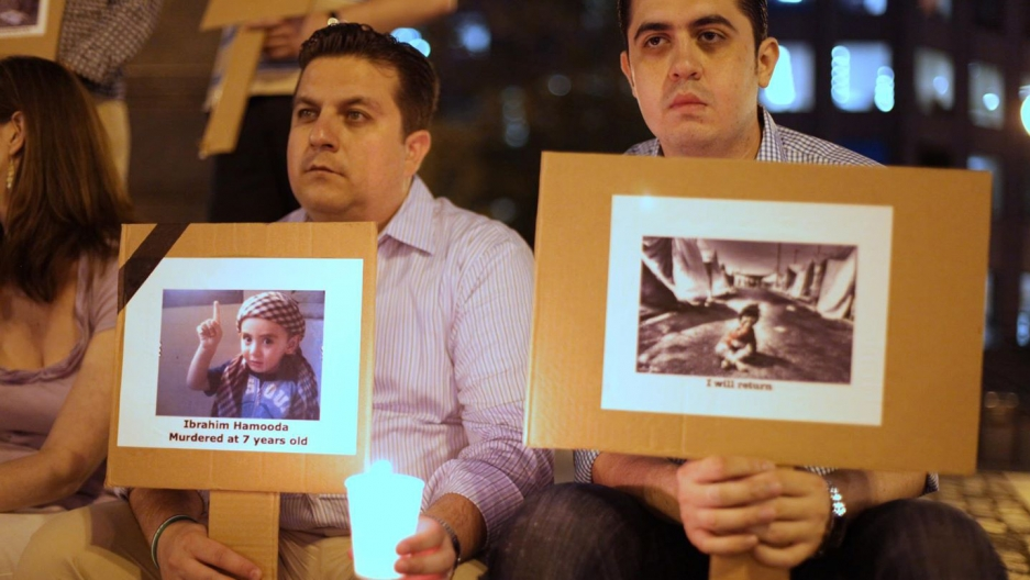 Mohamad Al Bardan, right, at a vigil for Syrian refugees at Faneuil Hall in Boston. (Courtesy of Mohamad Al Bardan)