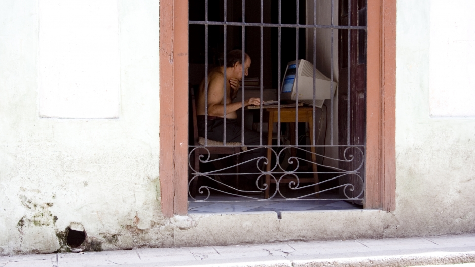 A Man Uses A Computer in Cuba