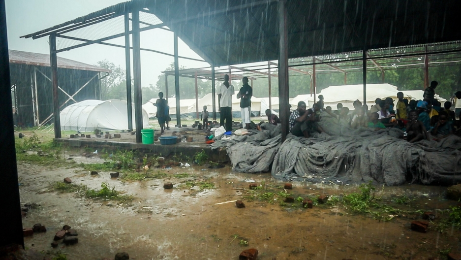 Malawians evacuated after devastating floods in late January wait out another deluge at a makeshift shelter. As many as 200,000 people have been displaced and crops were destroyed by what the country's president says is the worst flooding in its history.