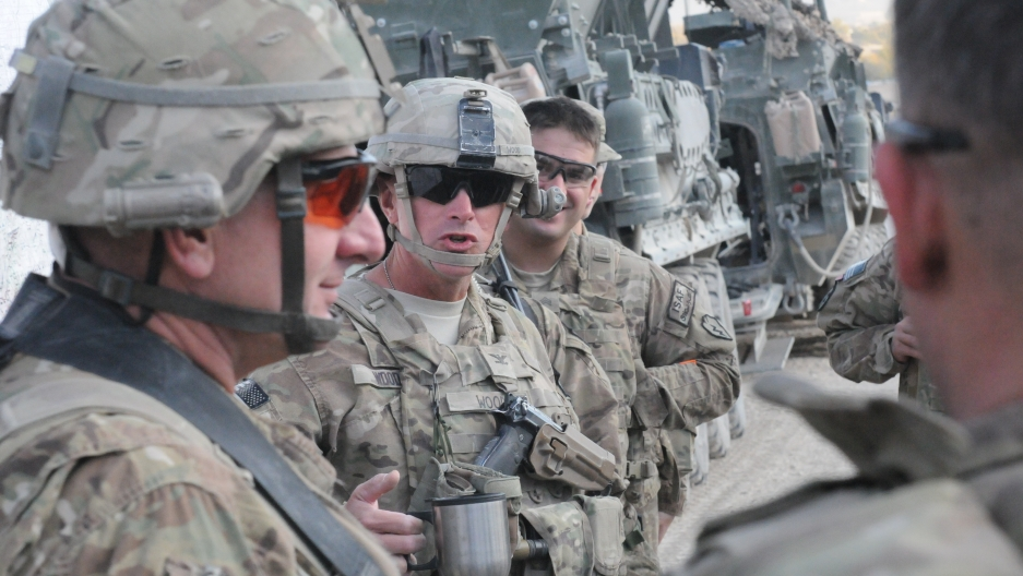 Col. Todd Wood, then commander of 1st Stryker Brigade Combat Team, 25th Infantry Division, talks with soldiers at FOB Masum Ghar in Kandahar province, Afghanistan in 2011.