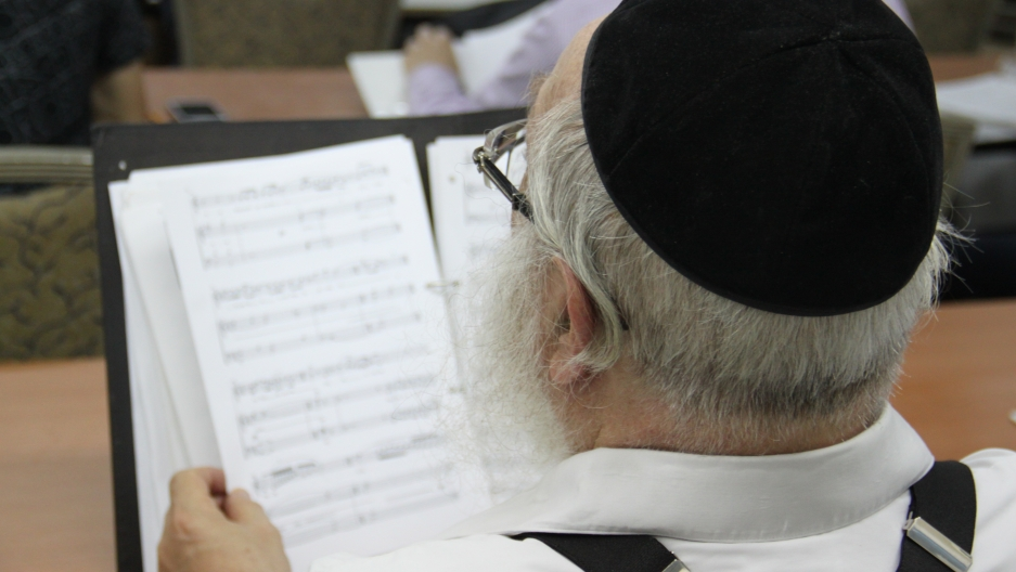 Cantor Chaim Adler looks over the sheet music from the Kol Nidre prayer, sung on the eve of Yom Kippur, the Jewish Day of Atonement.