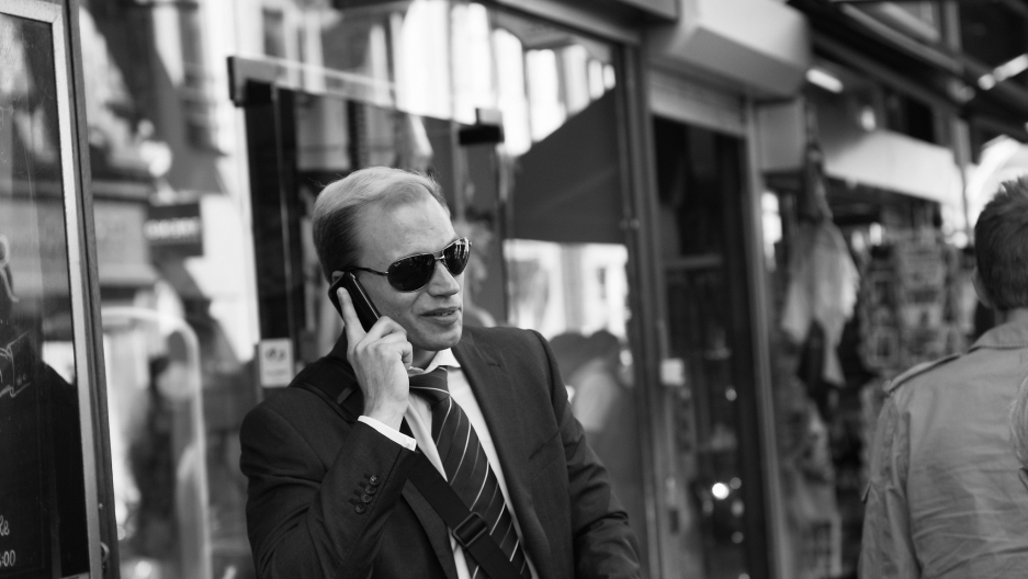 A man talking on his cell phone.