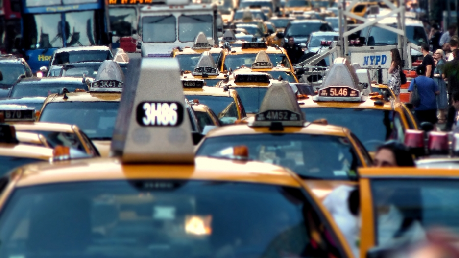 "Traffic piles up in New York City's Times Square. New York is one of the cities that attempted to introduce ""congestion pricing"" — fees for driving at peak hours — but the plan was defeated."