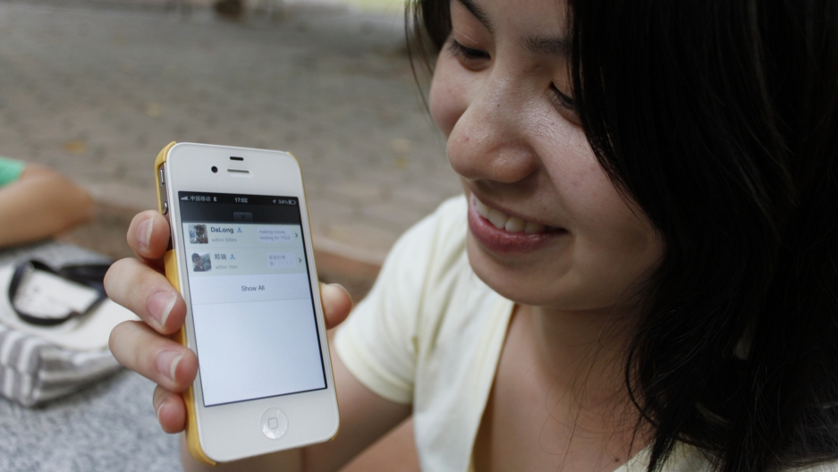 A WeChat user shows off the popular app on her phone.