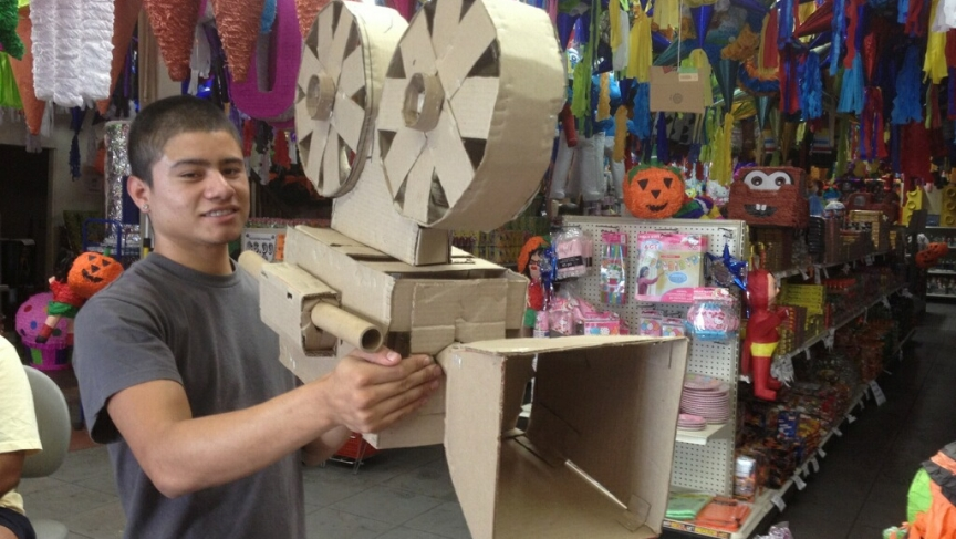 Juan Luis Garcia, a photographer and graphic designer, shows off the camera piñata he used to shoot promotional posters for the 20th San Diego Latino Film Festival in 2013.