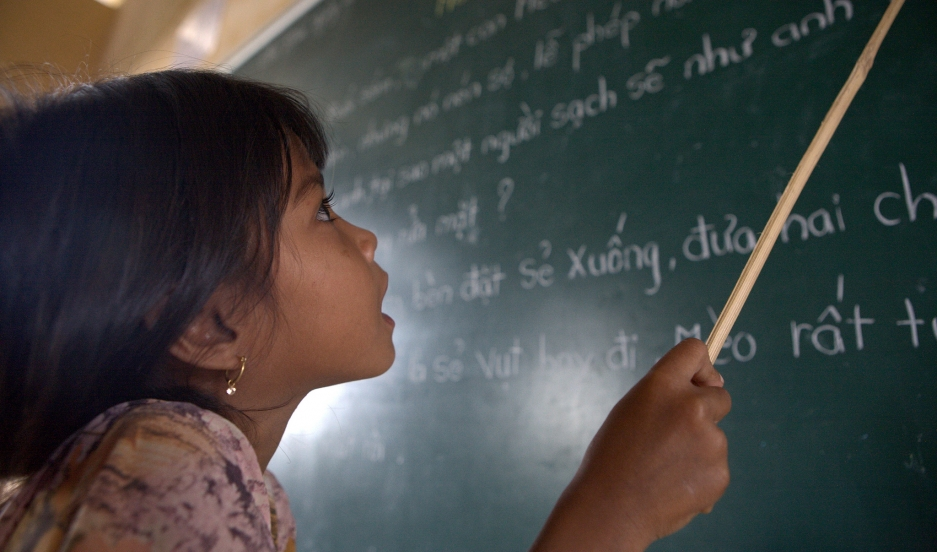 A student of Khmer descent learns Kinh language (the official Vietnamese language) at the Lac Hoa Primary School in Soc Trang province.
