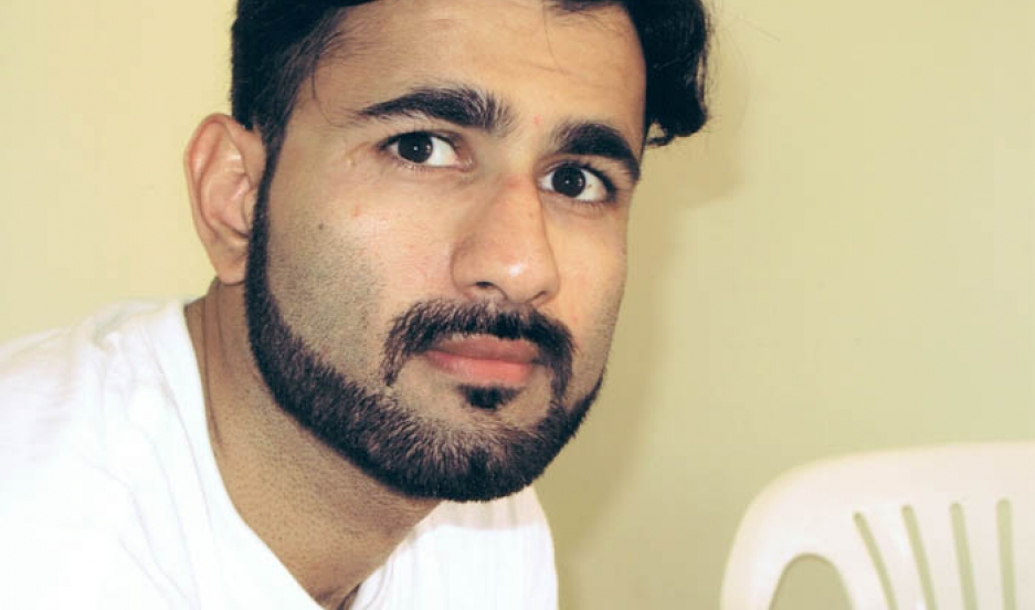 Magid Khan gained political asylum in the United States in 1998.