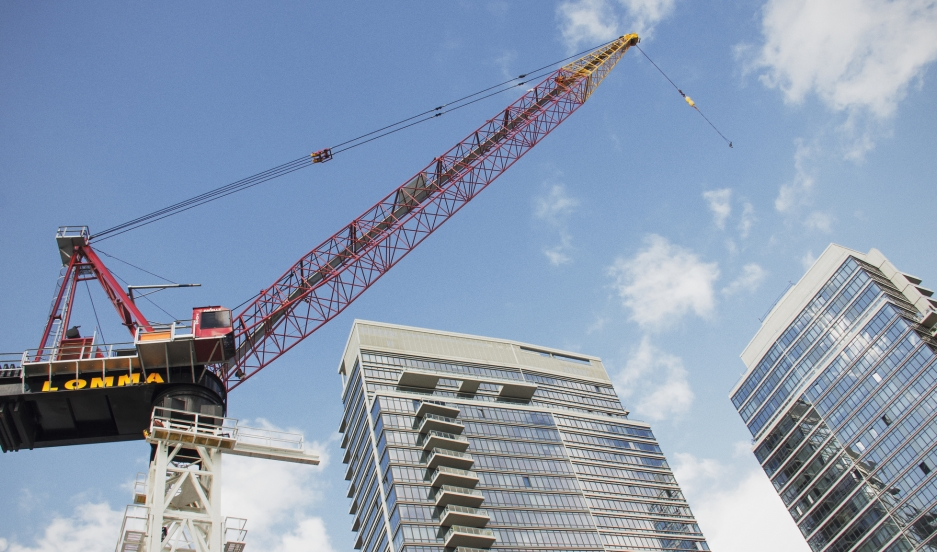A construction crane rises above a condo development in Brooklyn's Williamsburg neighborhood in 2013.