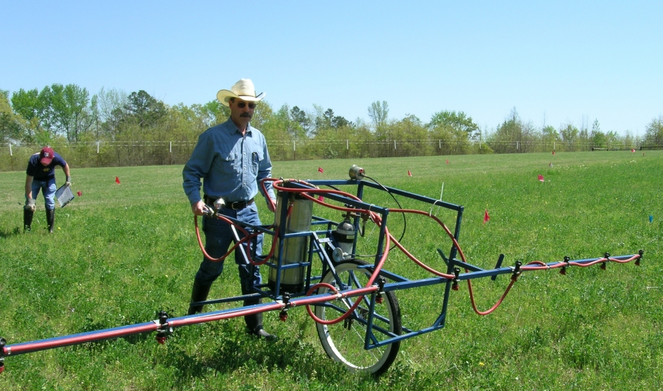 Allen Leonard, research associate with Texas A&M AgriLife Research, uses a custom spray rig to apply herbicide to Roundup Ready alfalfa test plots.