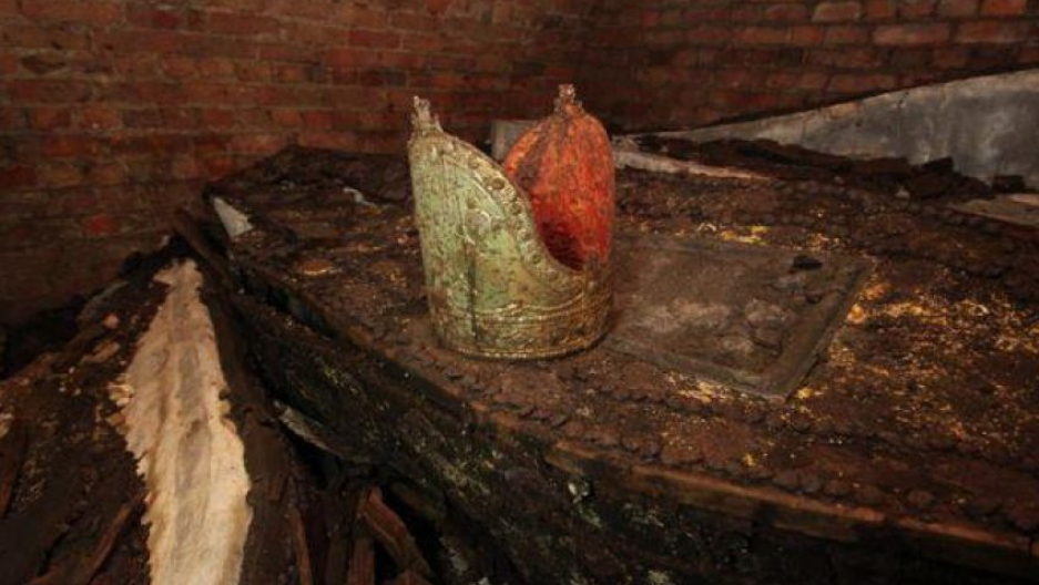 An archbishop's mitre rests on its owner's ancient lead coffin in a forgotten tomb in London