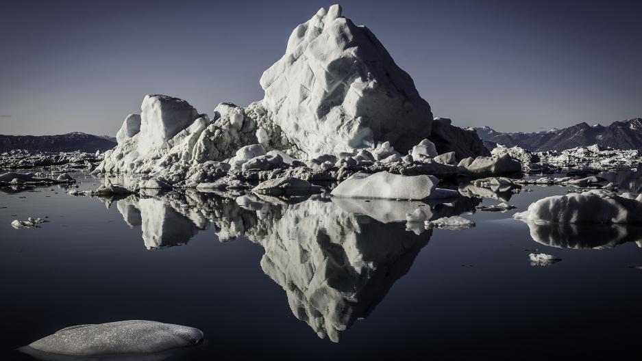 An iceberg from the Helheim Glacier in calm waters, Sermilik fjord, East Greenland.
