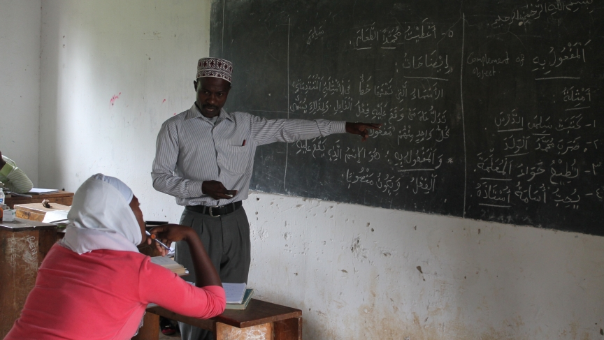 A student of Sumaiya Girls High School being taught Arabic