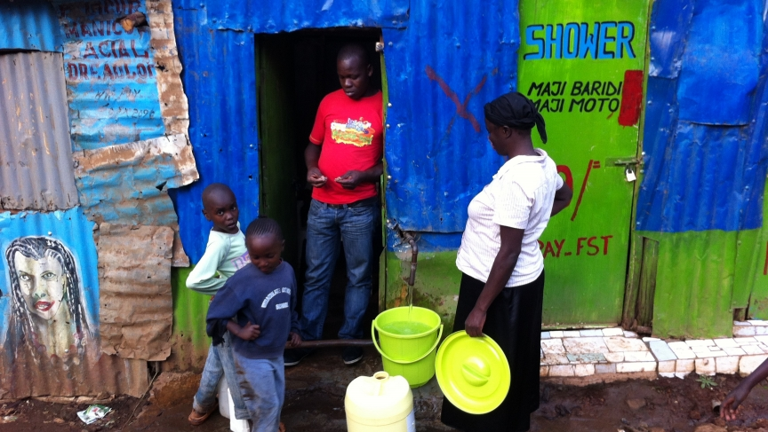 A water merchant in Nairobi sells to the city's poor.
