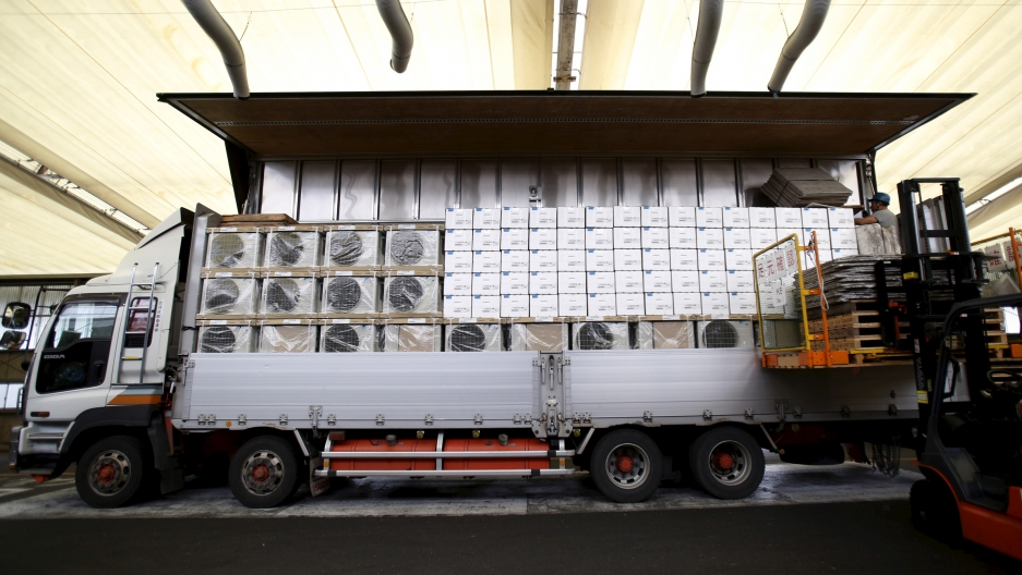 Air conditioners being loaded onto a truck for delivery. Most of the world's AC units cool air with chemicals that are big contributors to global warming. A new agreement forged in Kigali, Rwanda, will phase those coolants out over then next 30 years.