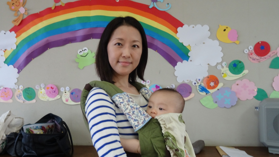 Aya Kanihara and her son Ayumu. Kanihara is taking maternity leave from her job in a Hiroshima office.