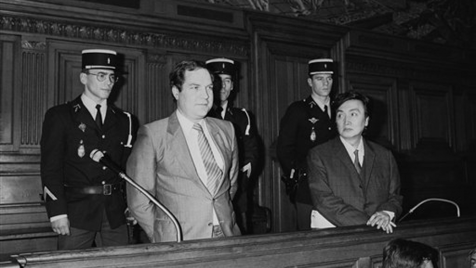 Former French embassy employee Bernard Boursicot, 41, left and Shi Pei Pu, 47, a singer in Chinese traditional opera face the judge as their trial began in Paris, May 5, 1986.