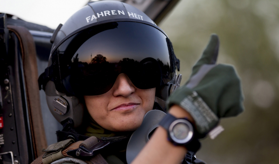 Ayesha Farooq, 26, Pakistan's only female war-ready fighter pilot, gives the thumb-up sign from the cockpit of a Chinese-made F-7PG fighter jet at Mushaf base in Sargodha, north Pakistan June 6, 2013.