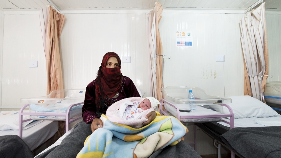 Um Mohammed and her newborn daughter called Shafagh at the maternity clinic in Zaatari refugee camp. The clinic is run by the Jordanian Health Aid Society and United Nations Population Fund.