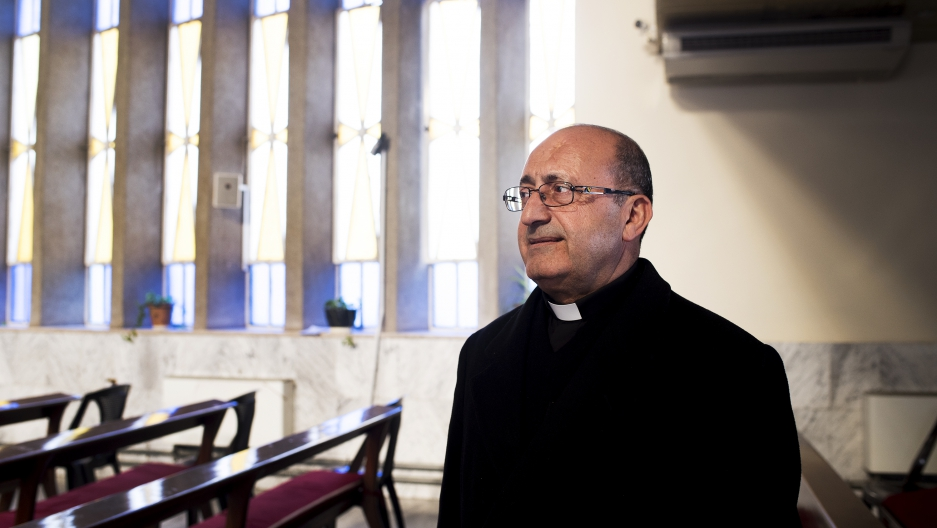 Father Khalil Jaar sits in St. Mary's church in Marka, 15 minutes outside of Amman, Jordan.