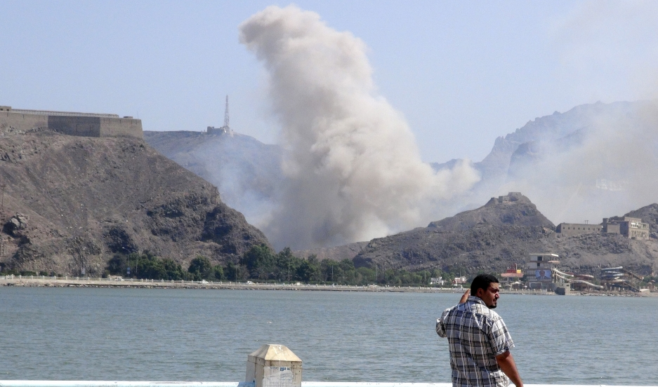 Smoke rises from an arms depot at the Jabal Hadeed military compound in Yemen's southern port city of Aden on March 28, 2015.