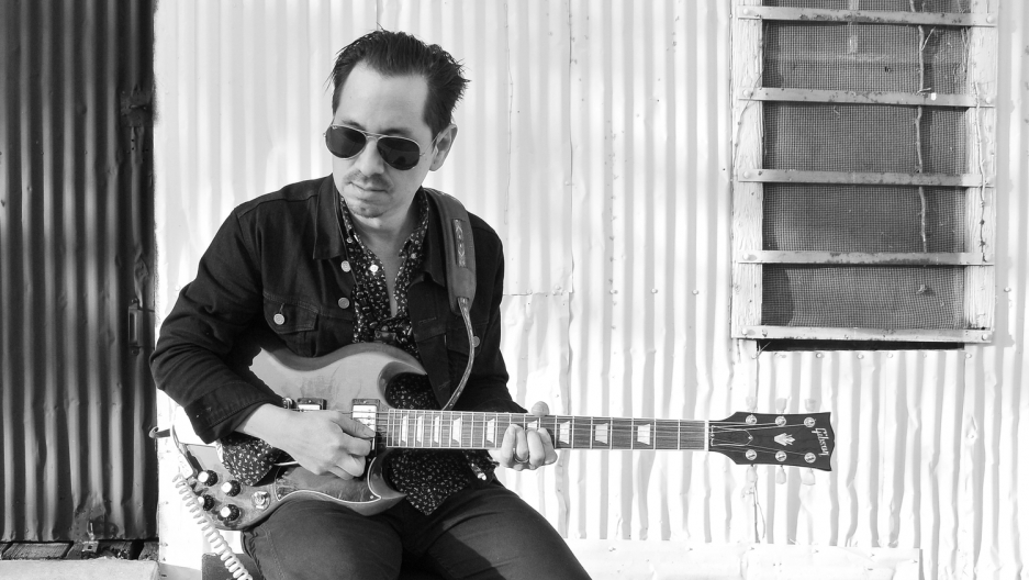 Musician Adrian Quesada grew up on the bordertown of Laredo, Texas