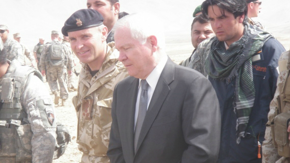 Afghan Ajmal Faqiri, wearing a scarf, served as a translator for former US Secretary of Defense Robert Gates
