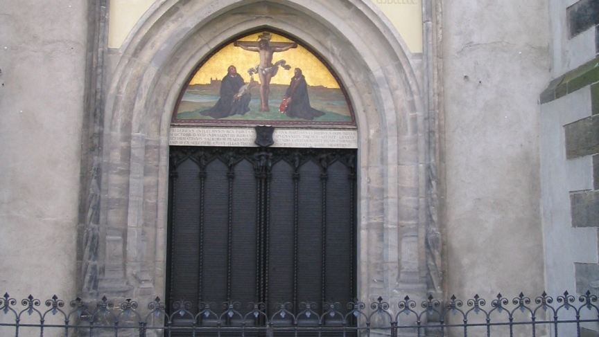 The door on the side of All Saints' Church in Wittenberg, Germany. In 1517, Martin Luther nailed his 95 Theses here sparking the Reformation. The original door was destroyed in a fire, but this black bronze door marks the historical spot.