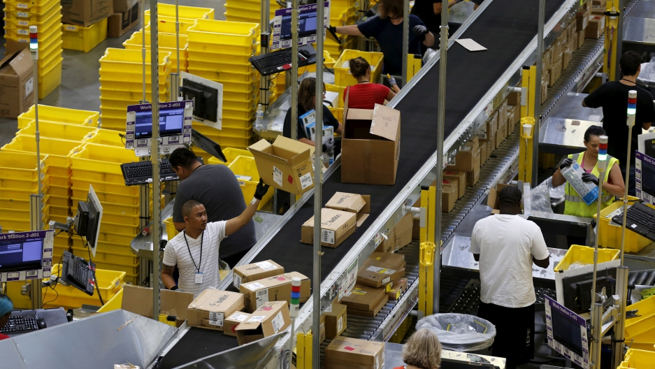 Workers sort arriving products at an Amazon Fulfilment Center in Tracy, Calif.