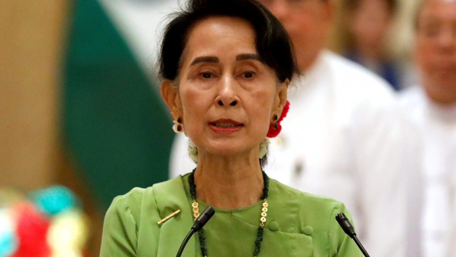 Aung San Suu Kyi speaking at a news conference in Myanmar.