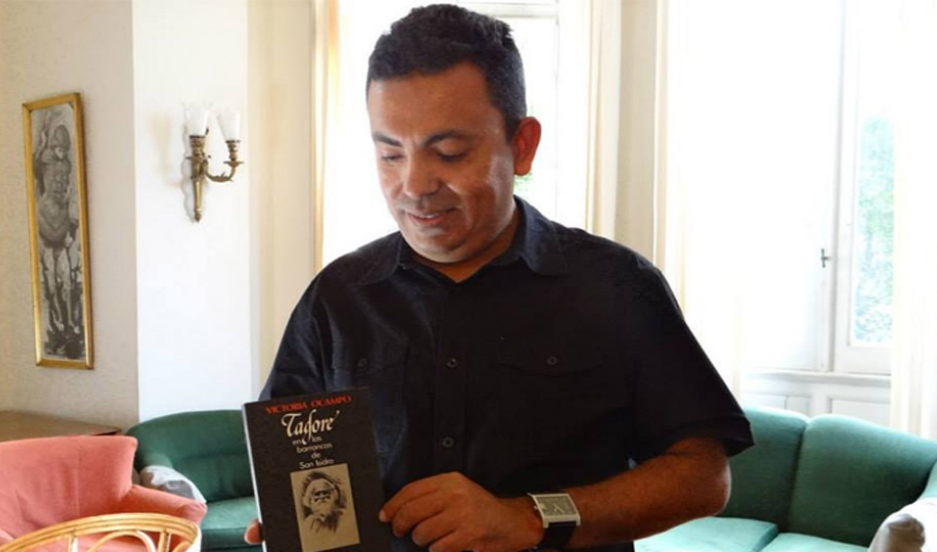 A photo of Bangladeshi American blogger, Avijit Roy, last year holding a book on Rabindranath Tagore. Roy blogged about scientific thought and apathy towards religion, taboo subjects in his home country of Bangladesh.