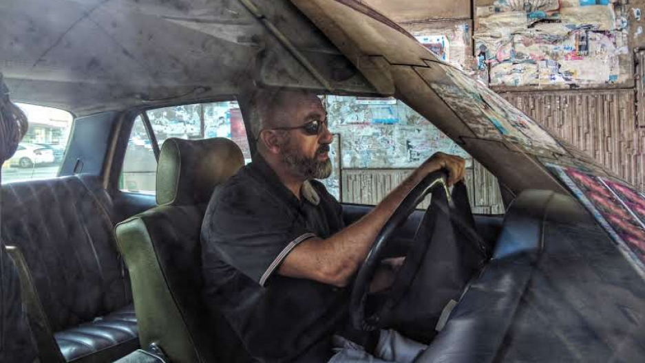 Taxi driver Gabriel Saad searches for passengers in Beirut.