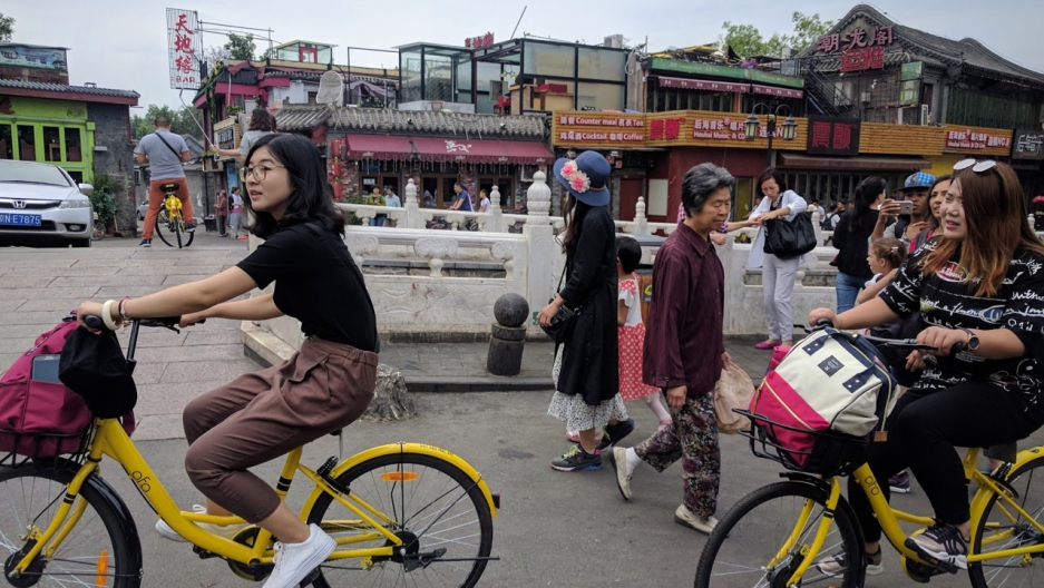 Riding bicycles in Beijing's Houhai neighborhood