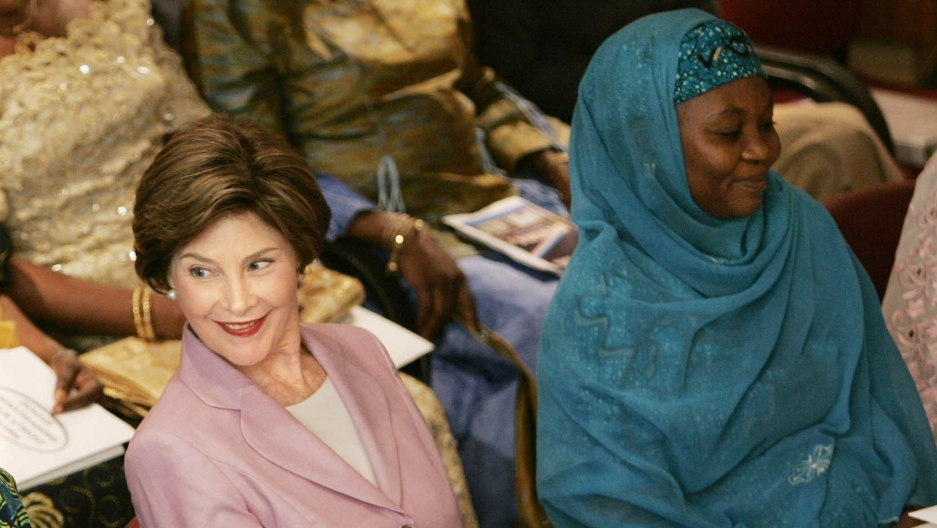 Hajia Bilkisu Yusuf sits with former first lady, Laura Bush, at the National Center for Women's Development in Abuja, Nigeria, January 2006.